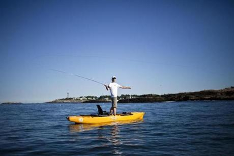 Gunnar Johnson went fly-fishing while balancing on a Hobie paddleboat in Marblehead.
